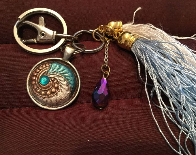 BB22 Keychain  White bronze charm, turquoise blue enamel, Swarovski  Crystal, clasp for bag, split ring for keys, 2 tassels