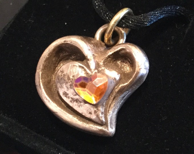 "CF045 Bronze Heart handmade, modern style, heart in a heart with a cubic zirconia amber color, heart-shaped stone, 18"" silk cord"