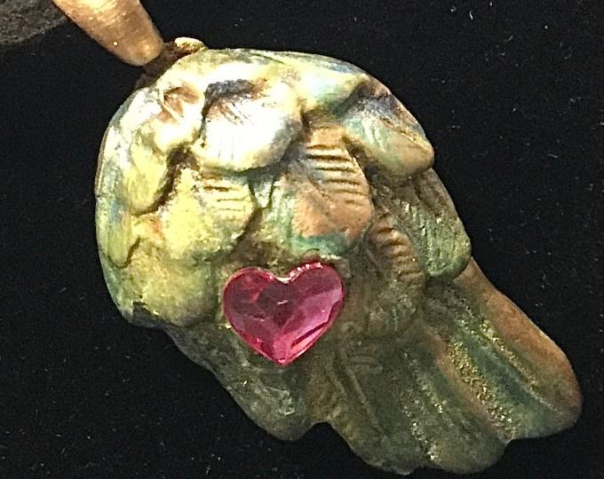 CF007. Bronze angel wing with cubic zirconia heart shaped garnet