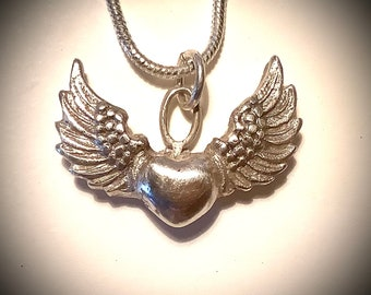 "11/20/1. Winged heart, made of .999 pure silver, very beautiful, all handmade, sterling silver 18"" chain"