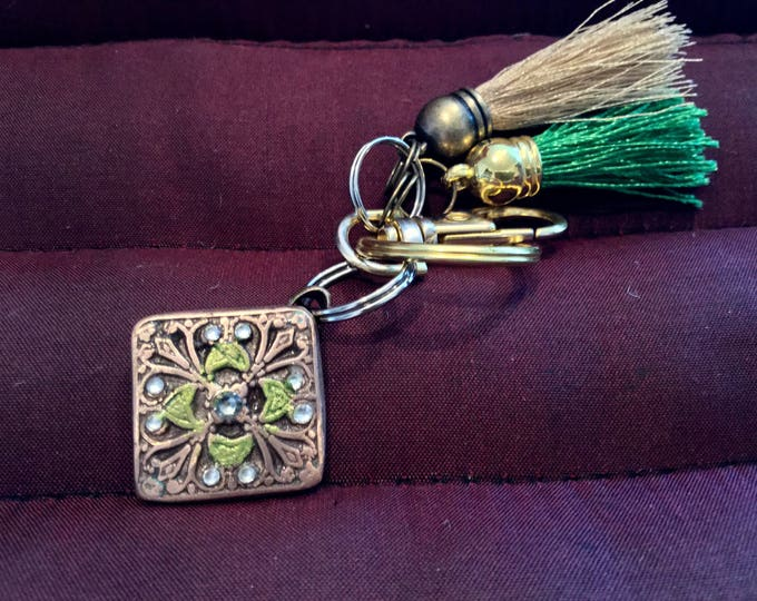 BB20 Keychain  Brilliant bronze charm, 9 Swarovski Crysrals ,  clasp for bag, split ring for  keys, gold and green tassels to match charm