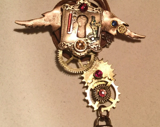 B64  STEAMPUNK pendant, handmade, one of a kind, cogs, wings, gems, watch parts, padlock, suede cord