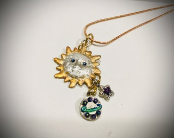 B1024 Pure silver .999 sun pendant w/sapphire eyes, dangling planet & star also pure sliver, all handmade, one of a kind, jewelers dye color