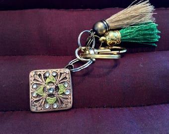 BB20 Keychain  Brilliant bronze charm, 9 Swarovski Crysrals ,  clasp for bag, split ring for  keys, gold and green tassels to match charm