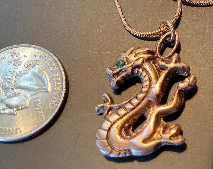"""B521.  Bronze dragon, handmade, rose bronze, green Swaroski Crystal eye, 18"""" bronze chain"""