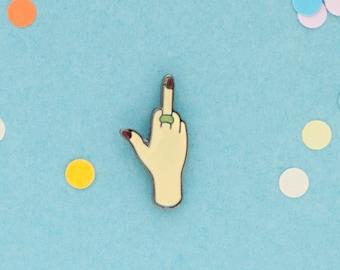 Middle finger enamel pin