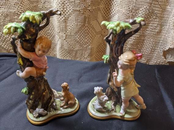 FREE SHIPPING- Pair of  2-Vintage Ginori Porcelain Capodiamonte Figurines. Signed by Bruno Merli. Boy treed by puppy and Girl training puppy