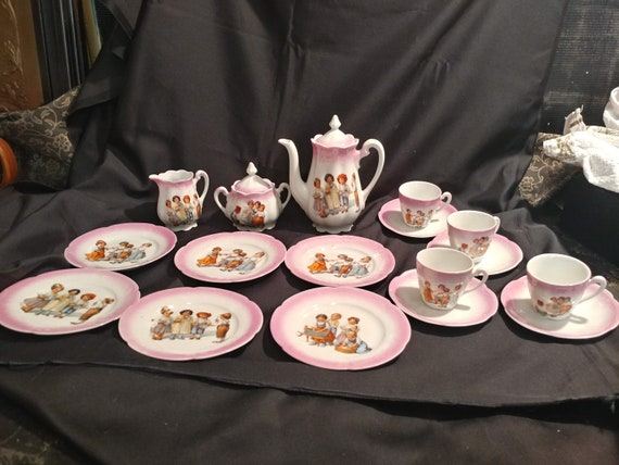 "FREE SHIPPING- 19 Pc. Children's Porcelain Tea Party Set. Red ""GErmany"" Stamp on Back of items. Pink Trim with Playing Children Design"