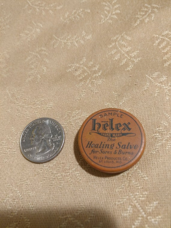 "FREE SHIPPING- Vintage ""Helex Healing Salve"" Sample Hand Salve Tin. Excellent Graphics on Both Sides. 1-1/16"" Diameters Across."