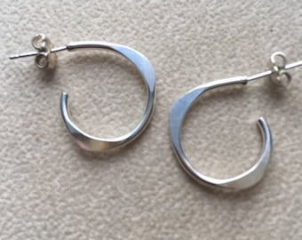 Sterling silver forged small earrings.