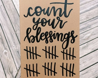 """Hand-lettered """"count your blessings"""" Kraft notebook"""