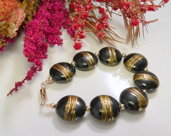 Black and Gold Glass Beads with Gold Filled Findings.