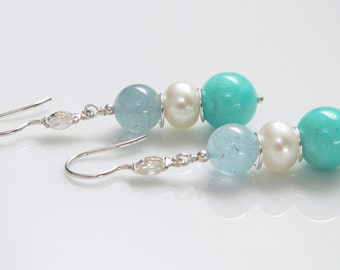 Peruvian Opals, Freshwater Pearls and Aquamarine Stones with Sterling Silver Findings.