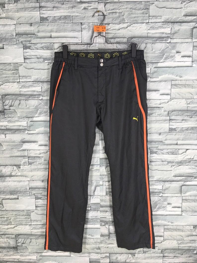4820c6a4cd7b Vintage PUMA Tracksuit Pants Black 90 s Women Puma Track