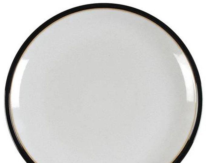 Denby | Denby-Langley Black Pepper stoneware salad or side plate. Solid black, white center, tan rim.