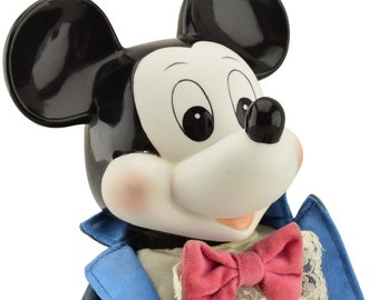 Mid century Mickey Mouse porcelain wind-up doll. Plays The Mickey Mouse Club Theme Song when wound. Made in Japan.