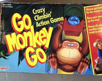Vintage (1989) Go Monkey Go game made by Galoob. Unused in box. Complete.
