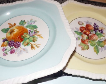 Pair of almost antique (1920s) Johnson Brothers California square salad or dessert plates. Yellow, blue verge, fruit center, rope edge.