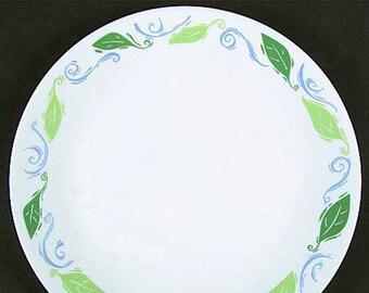 Vintage (late 1980s) Corelle | Corning | Corningware Spearmint dinner plate. Green leaves, blue swirls, white ground. Made in USA.