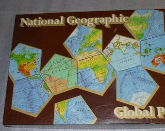 Vintage (1987) National Geographic Global Pursuit board game.  Complete and game pieces in like-new condition.