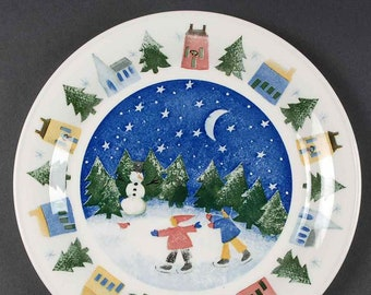 Vintage (1998) Nikko Japan Winter Wonderland pattern large dinner plate | charger.  Christmas tableware by Deb Mores. Skaters, snowman.