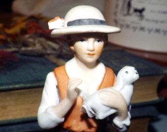 Vintage (1930s) porcelain bisque figurine.  Made in Korea. Blue crossed swords mark to base. Unknown manufacturer.