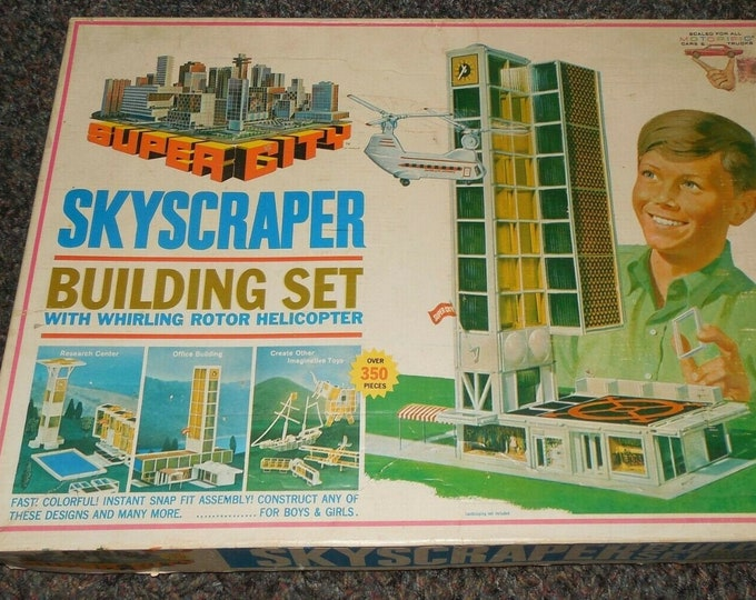 Vintage (1968) Ideal Toys Super City Skyscraper Construction Building Set. Motorized helicopter. Appears complete.
