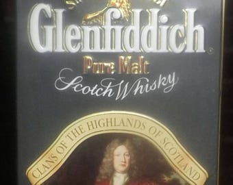 Vintage (1980s) Glenfiddich Clans of the Highlands Clan Sutherland 3rd Lord Duffus lithographed (empty) scotch whisky tin. Made in England