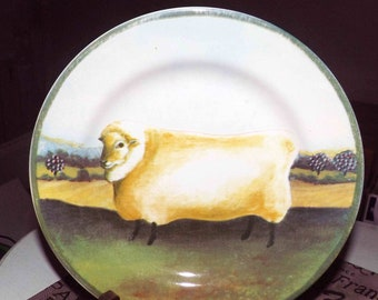 Vintage (1995) Country Farm salad or side plate by Block | Gear featuring a smiling sheep, ready for shearing.  Green rim.