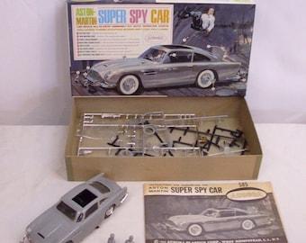 Vintage (1965) Aurora Super Spy Car model kit James Bond 007 made in Toronto Canada by Aurora Plastics.  Complete, partly assembled.