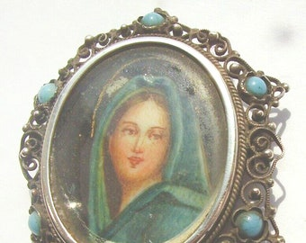 Antique (1910-1920) miniature hand-painted portrait brooch set in sterling silver marked 800 with turquoise | blue cabochon surround.