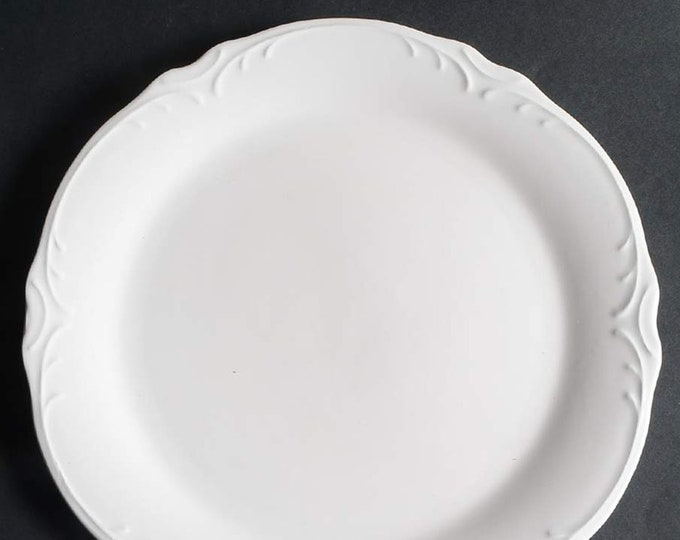 Pier 1 | Pier One Imports Madeline pattern large dinner plate | charger.  All-white ironstone with embossed scrolls. Discontinued 2017.