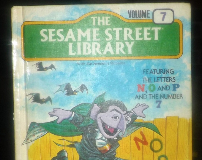 Vintage (1978) The Sesame Street Library Volume 7. Muppets teach the letters N, O & P and the number 7. Hardcover. Printed in USA.