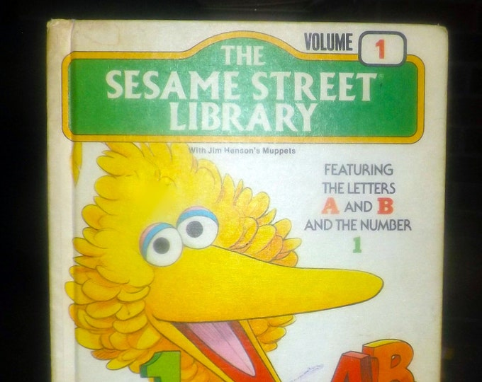 Vintage (1978) The Sesame Street Library Volume 1. Muppets teach the letters A & B and the number 1. Hardcover. Printed in USA.