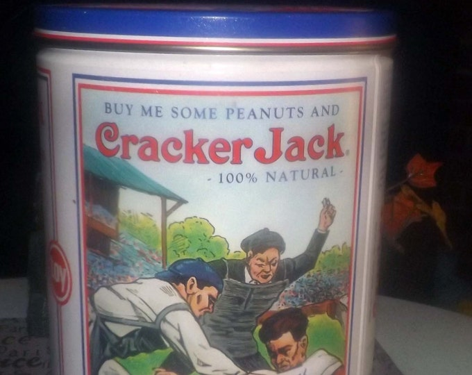 Vintage (1990) Cracker Jack tin with lid made in USA.  Vintage Cracker Jack advertisements.