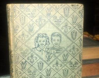 Mid-century (1950) hardcover book The Bobbsey Twins of Lakeport by Laura Lee Hope. Complete. Volume 1 in the series. Grosset Dunlap New York