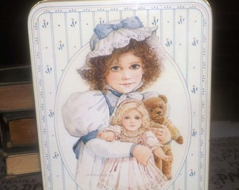 Vintage (1984) Sara May by Jan Hagara porcelain doll tin with lid (no doll inside). Great vintage kitchen or playroom storage or sewing box.