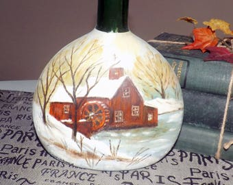 Vintage (1960s) hand-painted bottle with image of a mill in winter.  Painted by Alfred E. Whitehead, Peterborough, ON Canada.