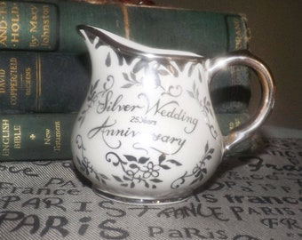 Mid-century Arthur Wood 25th Silver Anniversary hand-decorated mini creamer. Platinum edge, accents, wording and pink roses.
