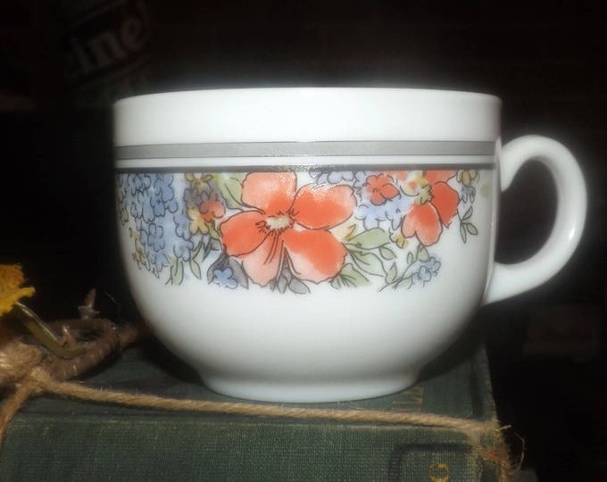 Vintage (1980s) Arcopal France glass orphan tea | coffee cup only (no saucer). Orange and blue flowers, black and grey bands on white.
