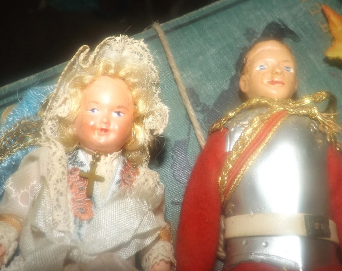 Pair of mid-century (1950s) jointed plastic, hand-painted dolls. Boy in British Officer's red-coat uniform, girl with bonnet, cross.