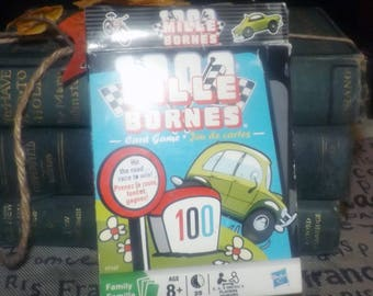 Mille Bornes auto race card game based on an original mid-century French card game. 100% Complete.  Made by Hasbro c.2009.