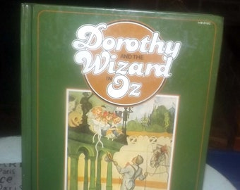Vintage (1980) hardcover illustrated children's book Dorothy and the Wizard in Oz by L. Frank Baum. Illustrations by John Neill. Complete.