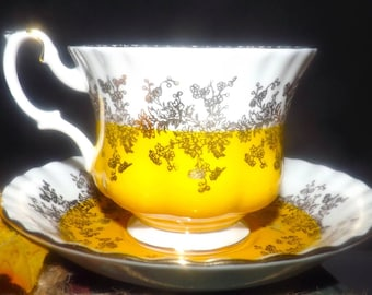 Vintage (1970s) Royal Albert Regal Series sunshine yellow and gold filigree tea set (footed cup with matching saucer). Gold edge, accents.
