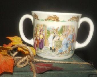 Vintage (1986) Royal Doulton Bunnykins double-handled loving cup | mug for baby. Bunnykins celebrate a Christening. Flawed (see below).