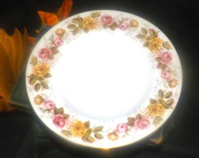 Vintage (1930s) Coalport Rosalinda rimmed soup bowl made in England. Pink and yellow roses, gold edge.