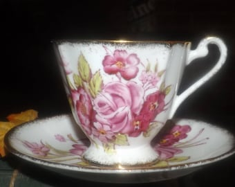 Early mid-century (1940s) Roslyn Bone China England hand-painted tea set (footed cup with saucer).  Pink roses, brushed-gold edge, accents