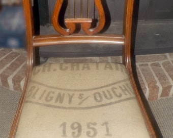Mid-century (1950s) Duncan Phyfe dining chair. Solid walnut, authentic mid-century French grain sack upholstery. Classic harp | lyre back.
