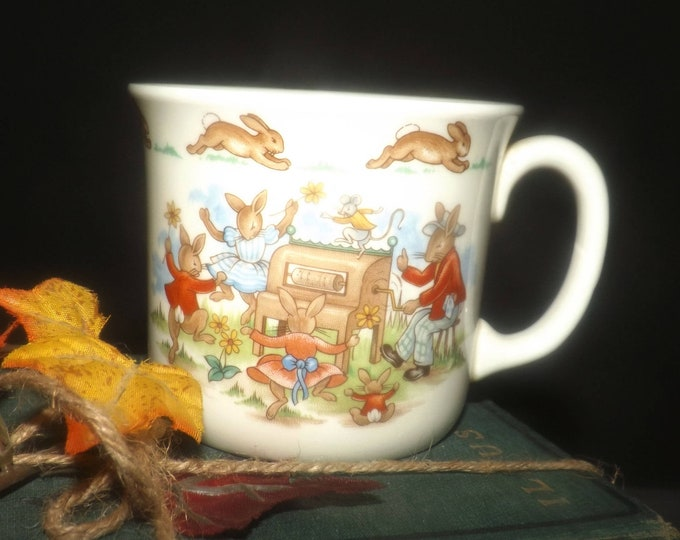 Vintage (1984) Royal Doulton Bunnykins child's cup | mug.  Bunnies on the player piano and skipping rope.
