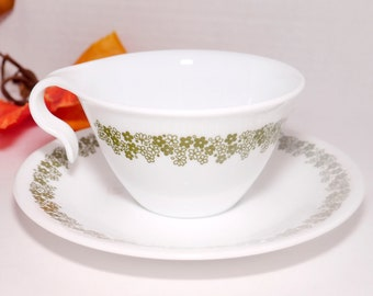 Vintage (1970s) Corelle Corning Spring Blossom hangable cup and saucer set. Green florals on white. Made in USA.